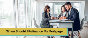 Couple meeting with a loan officer or broker in their home.