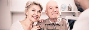 Older couple listening to their banker regarding their refinance plans.
